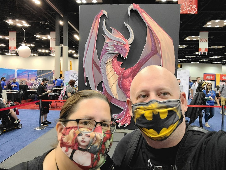 Image is of Consey and Suzanne in front of Genevieve at GenCon2021