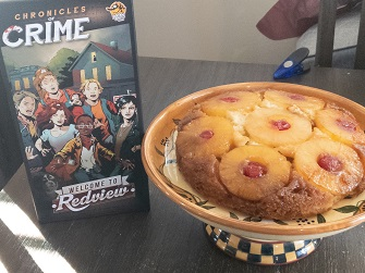Chronicles of Crime: Welcome to Redview Game box and Pineapple Upside Down Cake