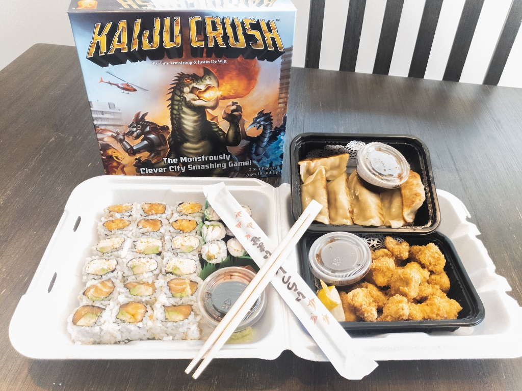 image is of sushi takeout and Kaiju Crush Game Box