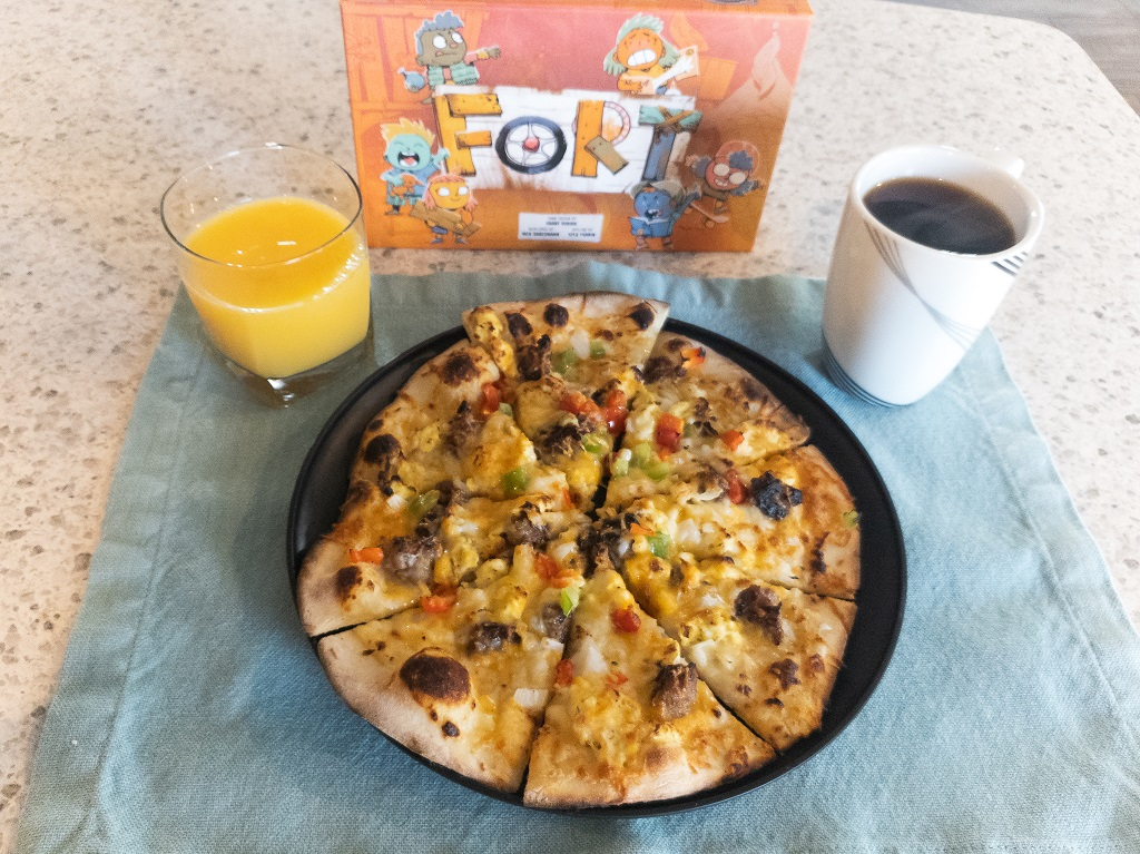 Image of Board Game Fort with Breakfast Pizza, Coffee, and Orange Juice