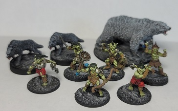 Image is of D&D figures: Goblins, Wolves, and a Polar Bear