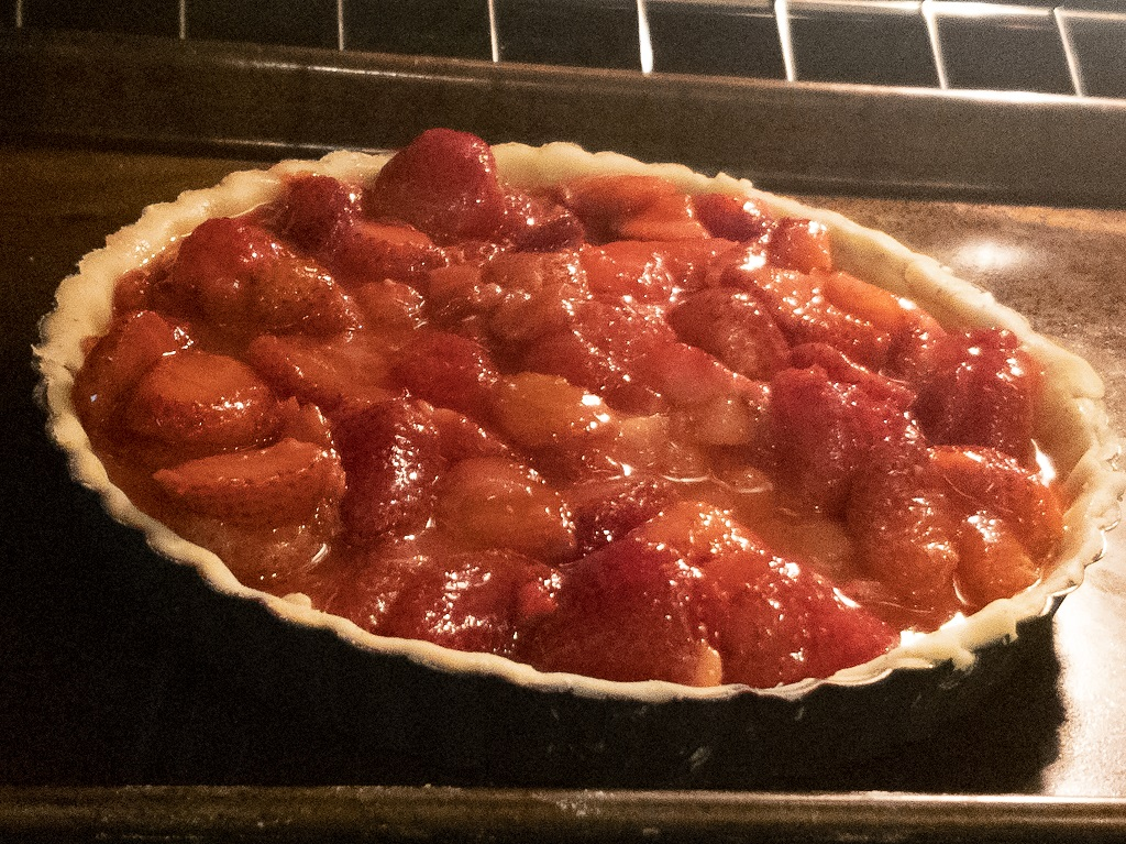 Image is of Medieval Strawberry Tart in Oven