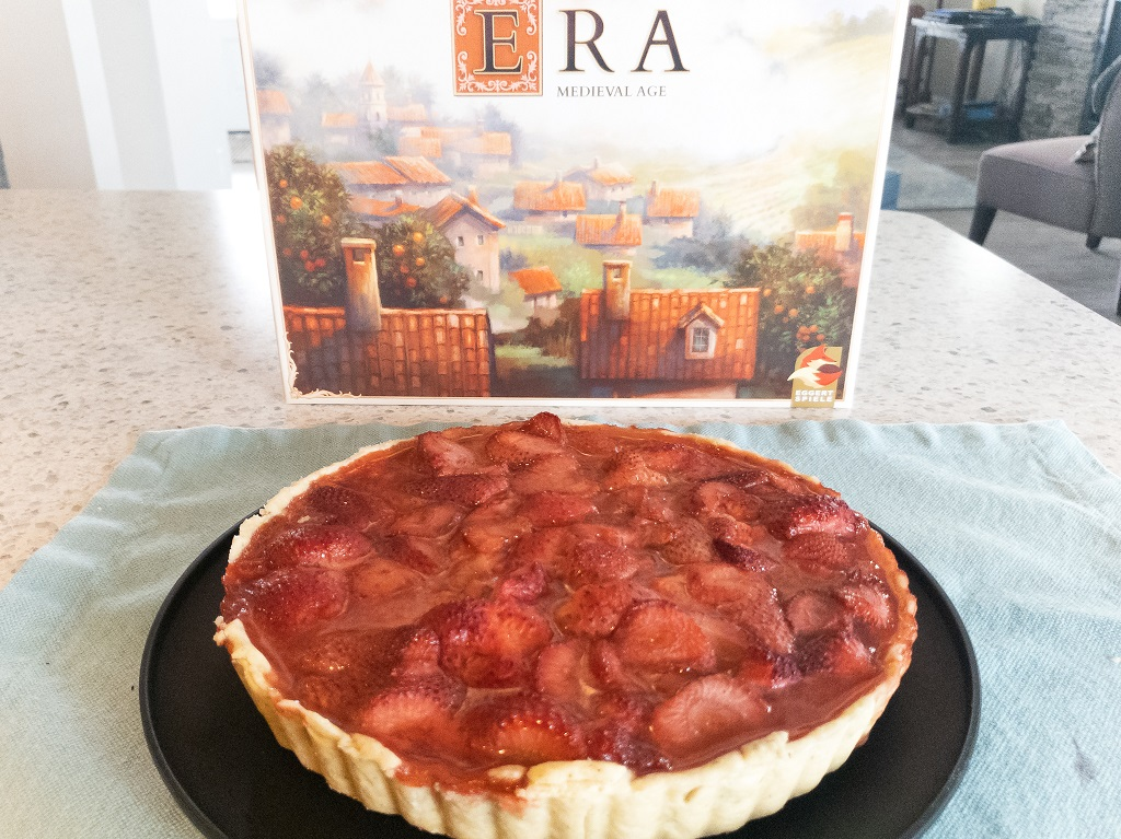 Image of Era game box and strawberry tart