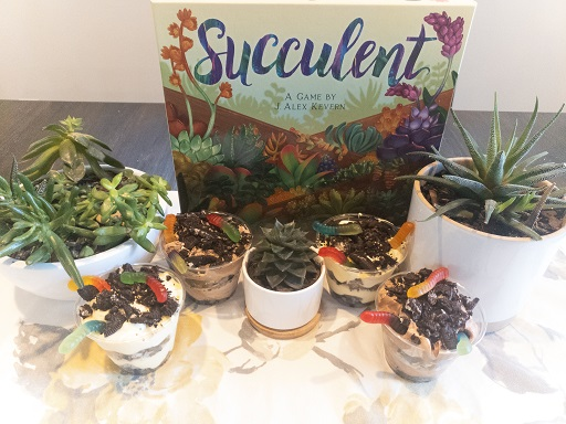 image is of Succulent game box, 4 dirt cup desserts and some succulent plants