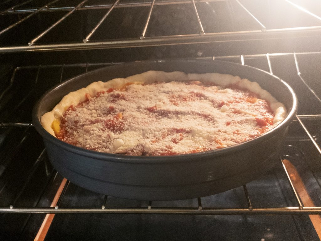 image of deep dish pizza in oven