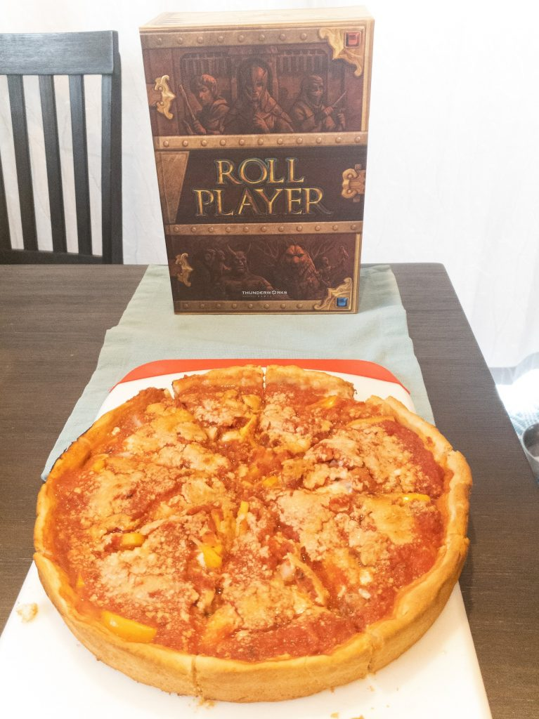 Image of Roll Player Box and Deep Dish Pizza