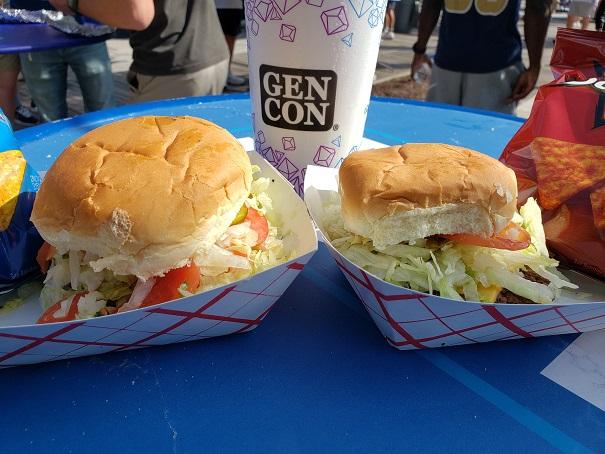 image of 2 burgers, Doritos and GenCon Soda Cup